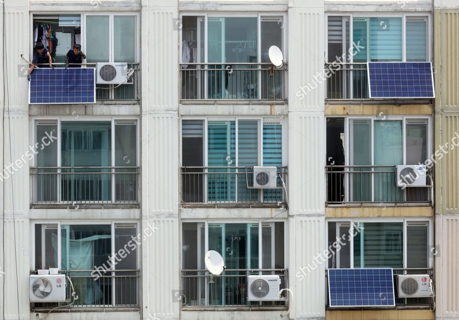 Workers install solar modules on apartment balconies Editorial Stock Photo  - Stock Image | Shutterstock