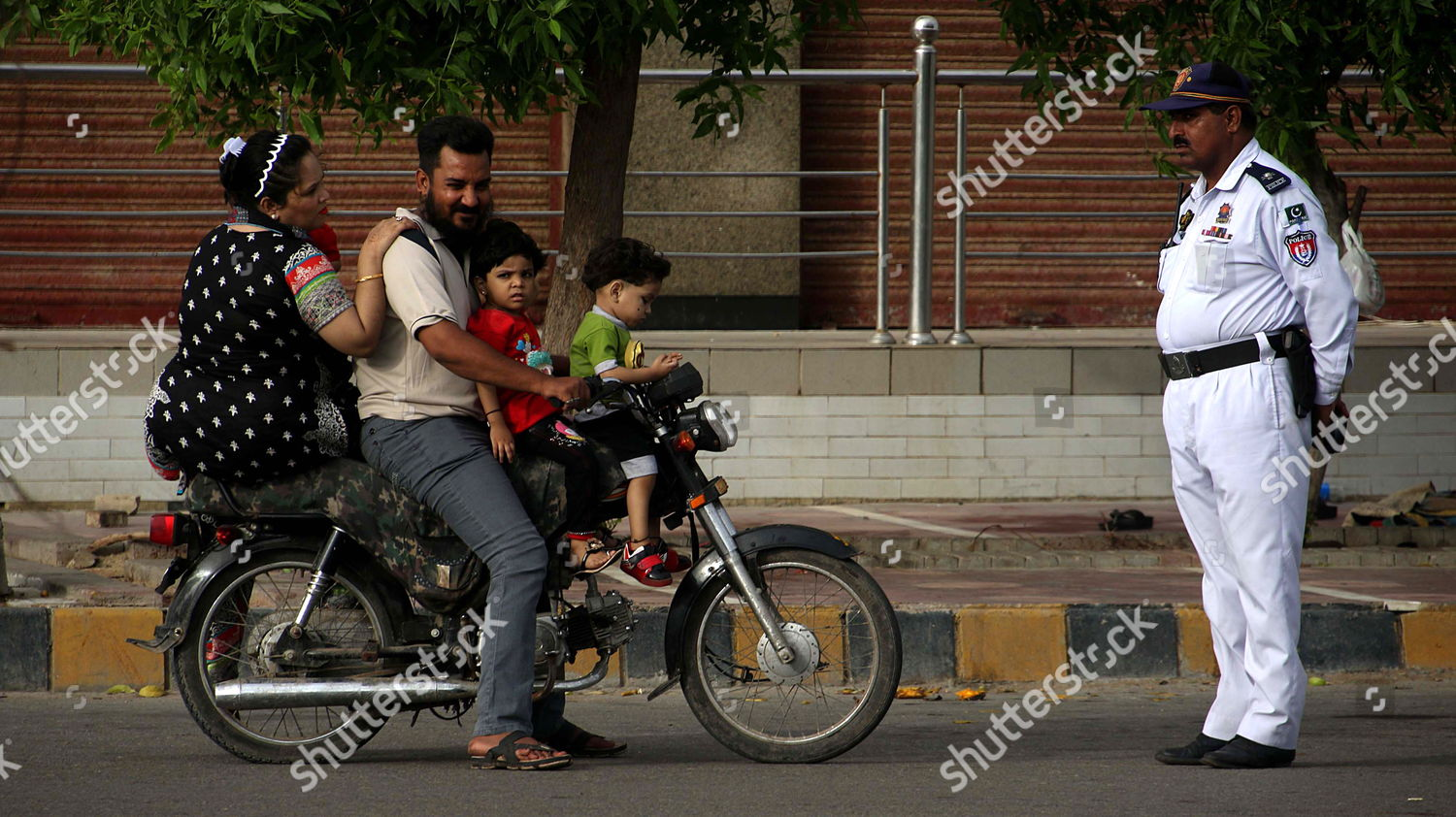 family rides on moter bike world observes Editorial Stock Photo