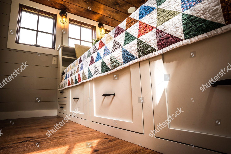 Interior shots Timbercrafts Tiny Homes bedroom storage