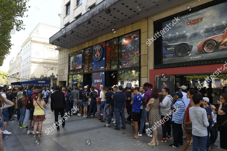 People queue outside Paris Saint Germain shop Editorial