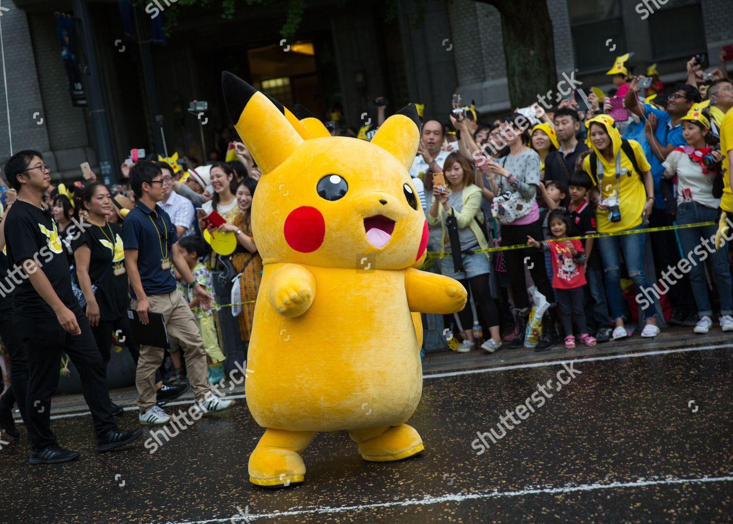Pikachu character marches during Pikachu Carnival Parade