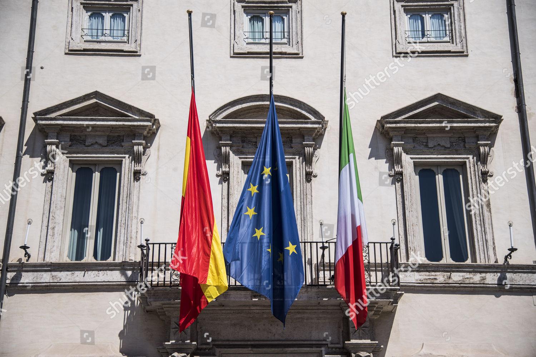 Italian European Spanish flags halfmast on balcony Editorial Stock