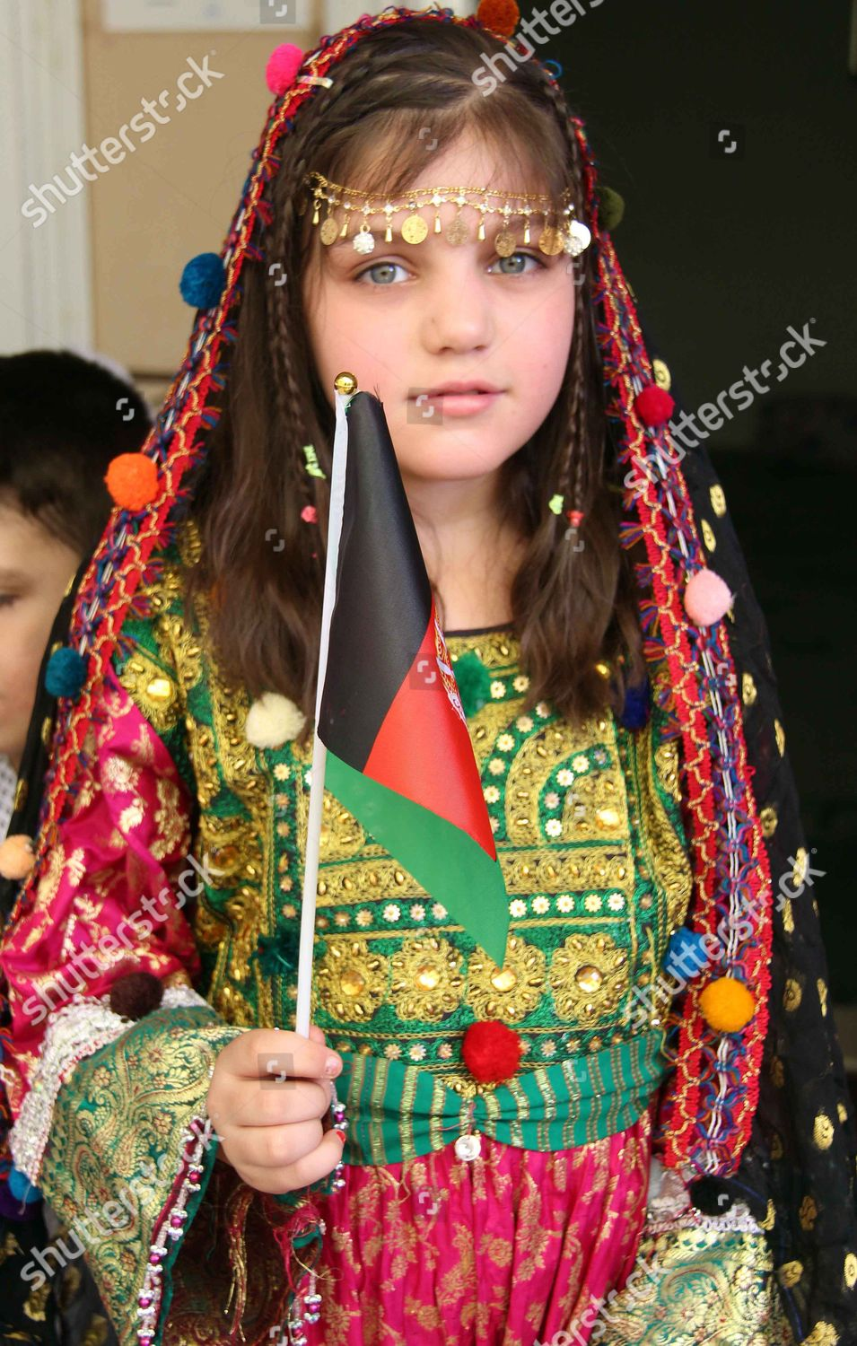 Afghan girl holds national flag wears traditional Editorial Stock