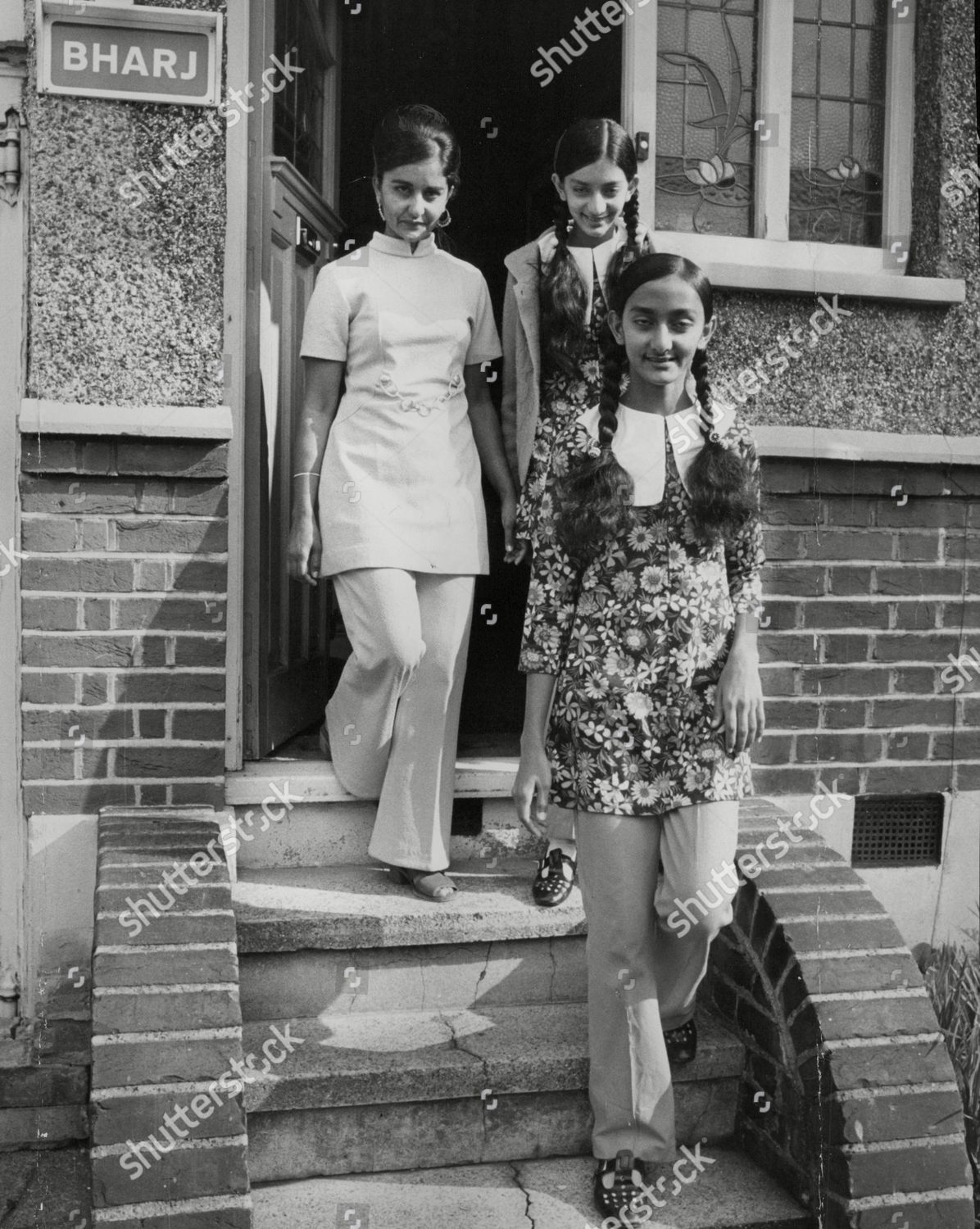 Stock photo of Asians Expelled From Uganda By President Idi Amin. Mrs Terchan Chana (l) And Daughters Inder 12 And Kaman 15 At Her Sister's Home In Harrow London. Box 745 207041737 A.jpg.