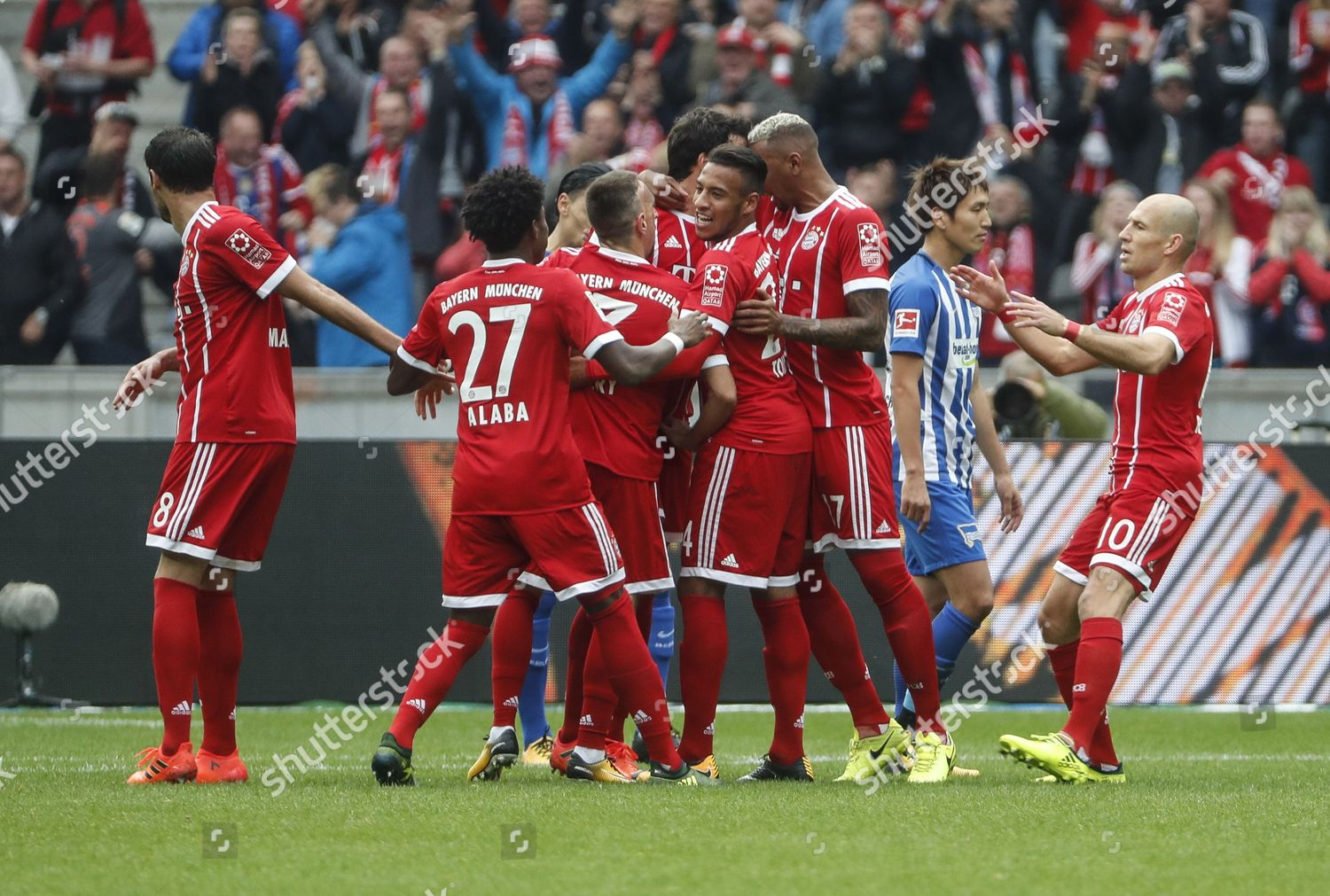 FC Bayern Munich players celebrate opening goal Editorial