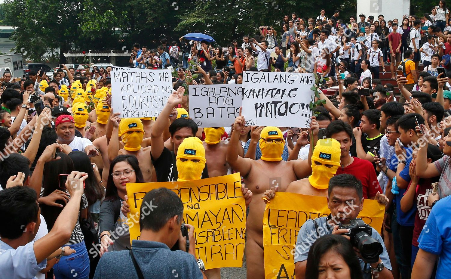 Ang Naked masked studentmembers school fraternity display placards