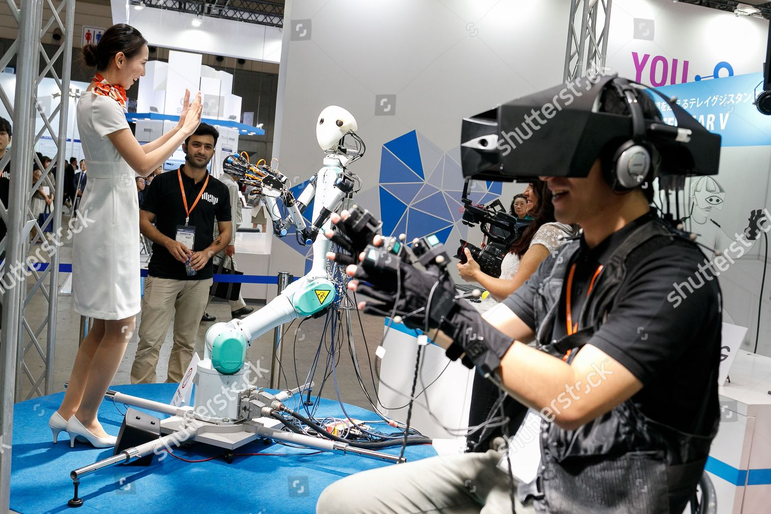 Exhibition Booth Assistant : Booth assistant interacts masterslave robot telesar v editorial