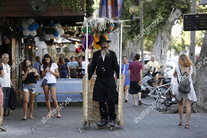 ultraOrthodox Jewish Shai Shuruk on roller blades Editorial Stock