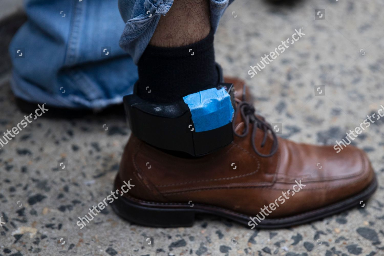 Javier Flores Garcia shows his ankle monitor Editorial Stock