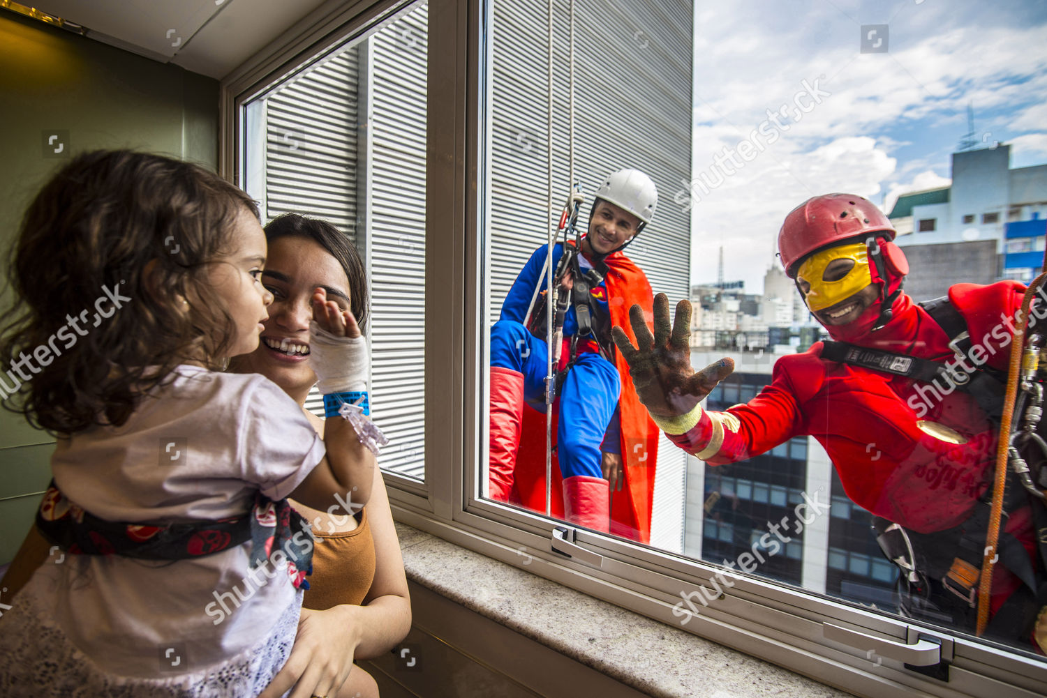 Window cleaners dress like superheroes Sabara Childrens Editorial Stock  Photo - Stock Image | Shutterstock