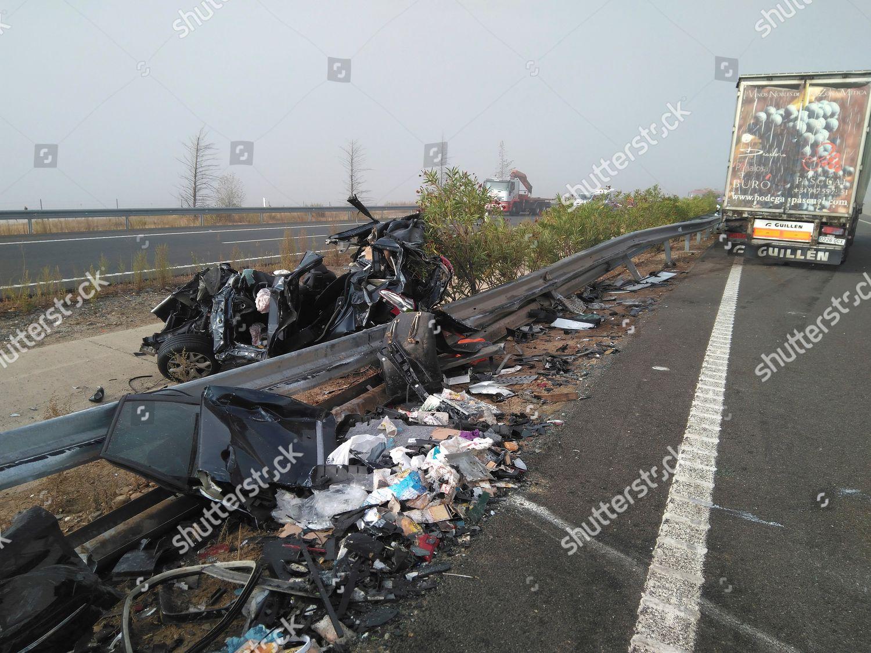 wreck totally damaged car seen between lanes Editorial Stock Photo