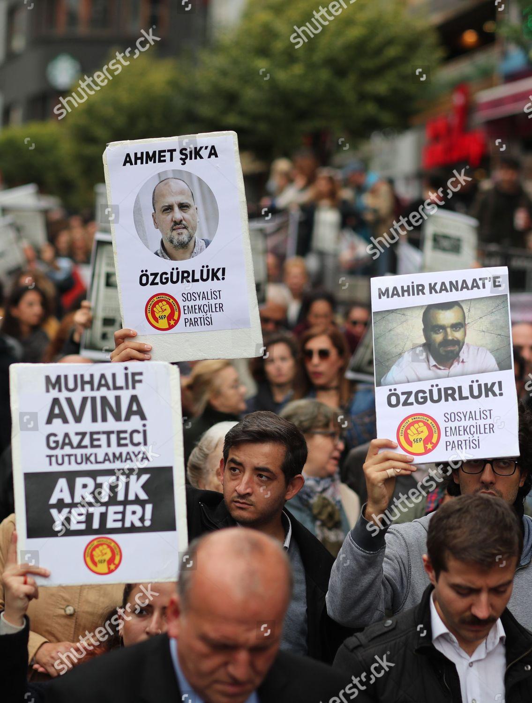 People shout slogans against government arresting