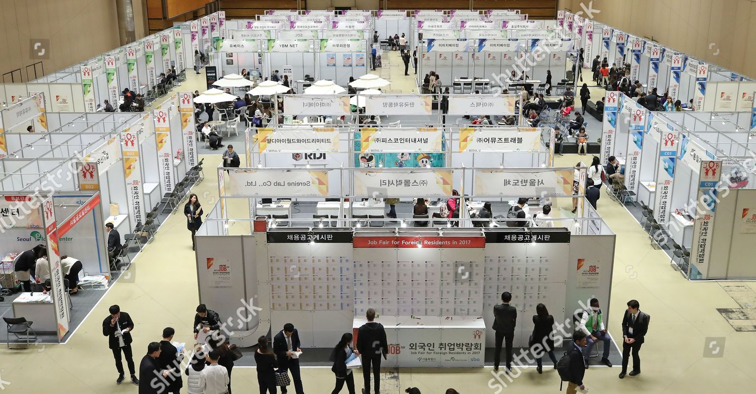 Foreigners look around booths job fair them Editorial Stock Photo