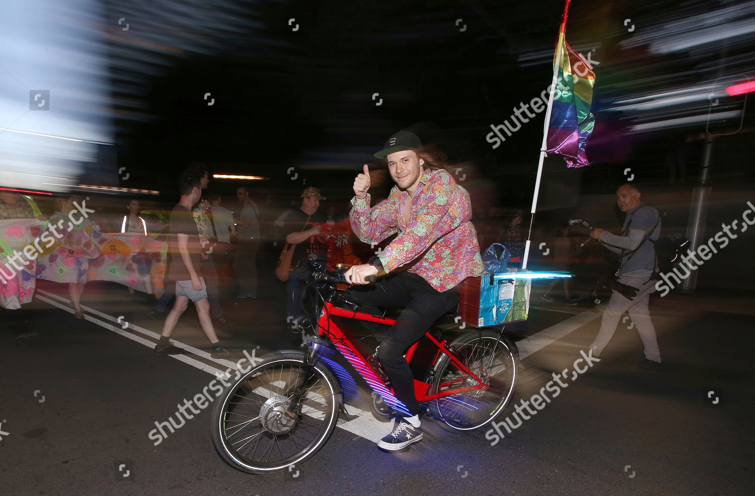 cyclist rainbow flag on his bike rides Editorial Stock Photo