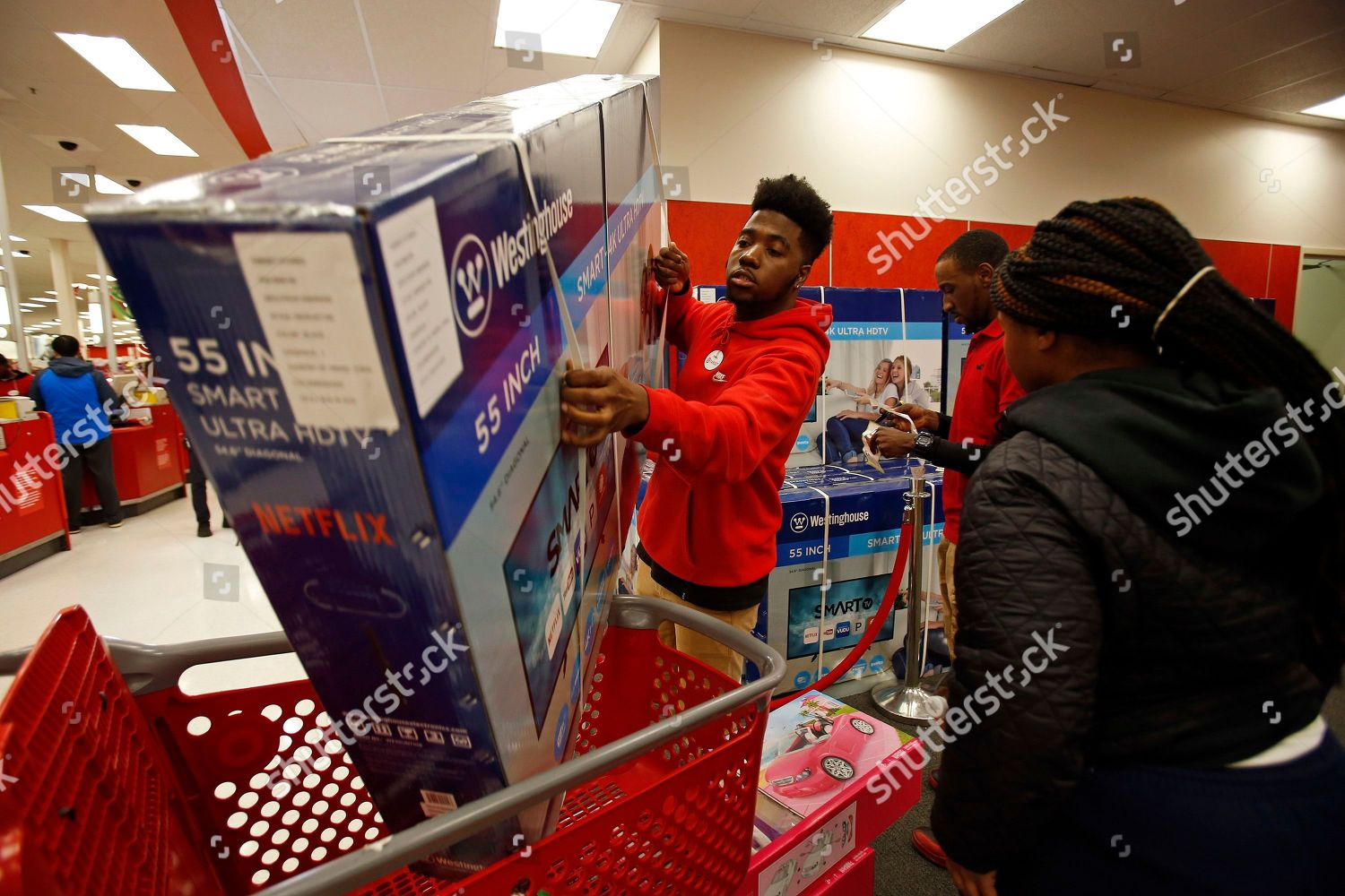 Target team member assists customer TV purchase Editorial