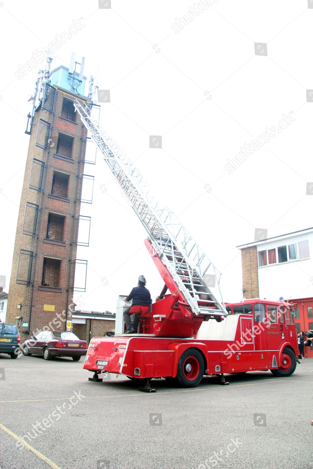 appluances 100 foot ladder pitched 4th foor editorial stock photo