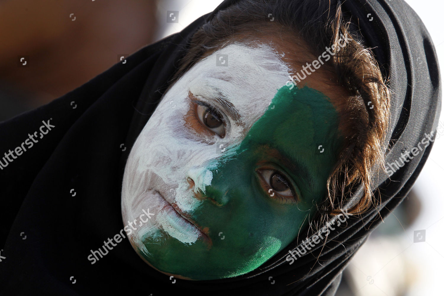 Houthi girl who has painted his face Editorial Stock Photo