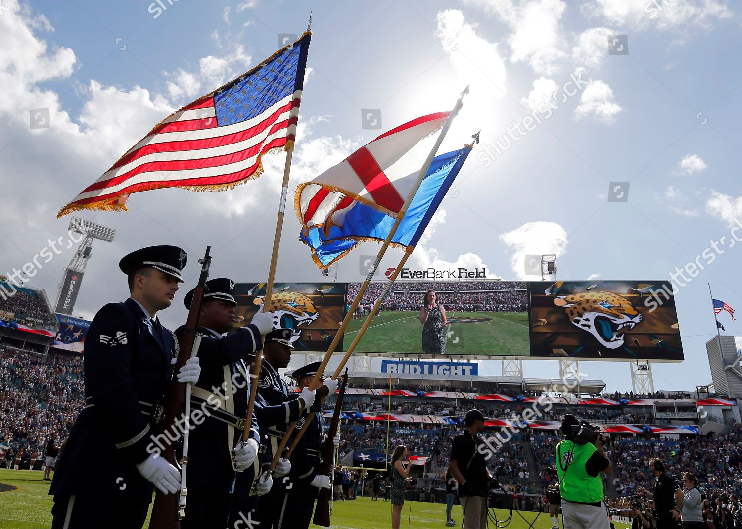 Color guard displays flags before NFL football Editorial Stock Photo