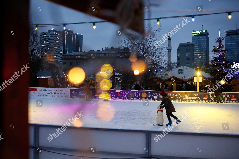 Christmas In Sarajevo.Bosnian Girl Skates Ice Rink Christmas Market Editorial