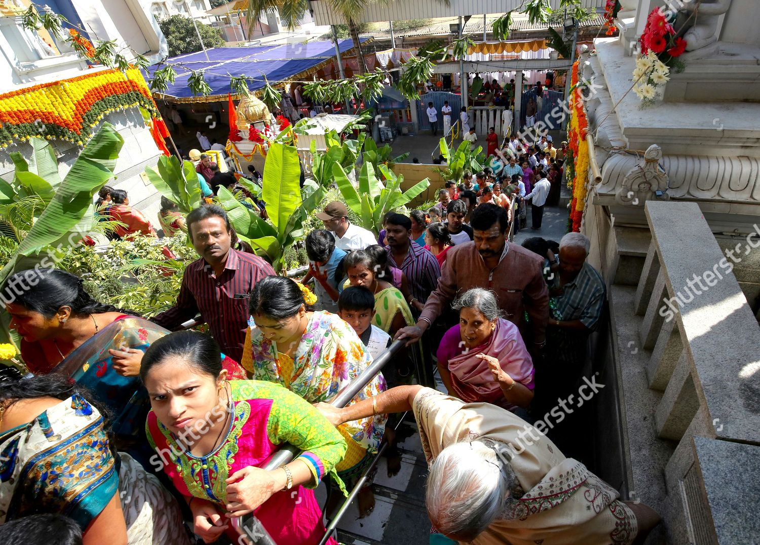 Indian Hindu Devotees stand queue chanting singing Editorial Stock