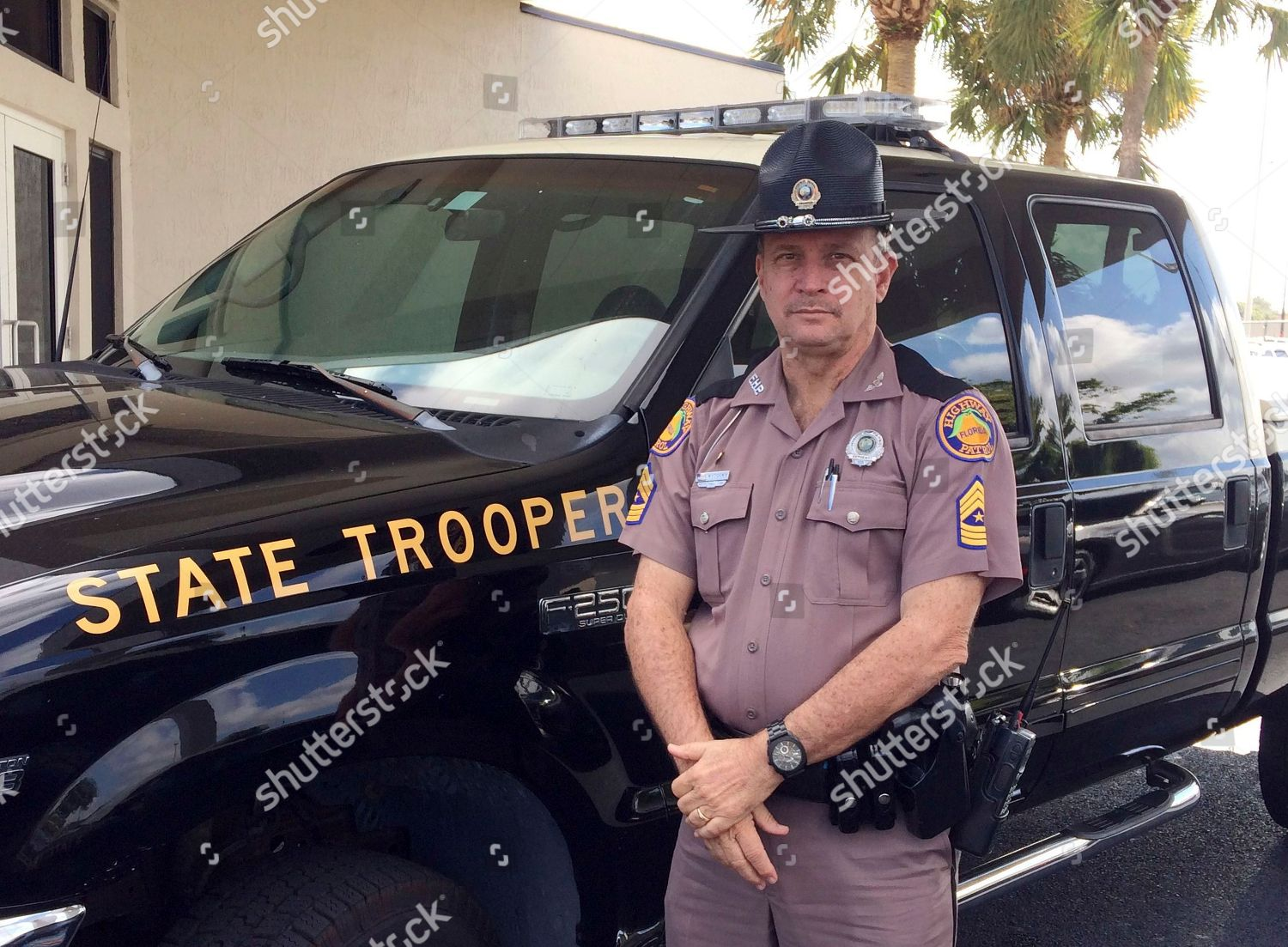 Florida Highway Patrol Sgt Mark Wysocky poses Editorial
