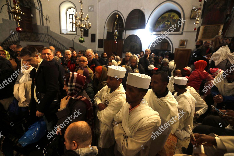 Eastern Orthodox Christmas.Worshippers Pray Inside Church Nativity During Christmas