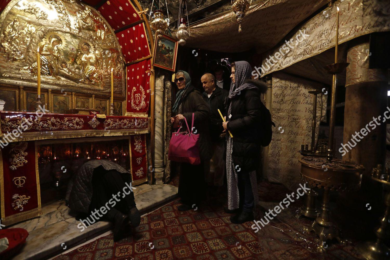 Eastern Orthodox Christmas.Worshipper Prays Inside Church Nativity During Christmas