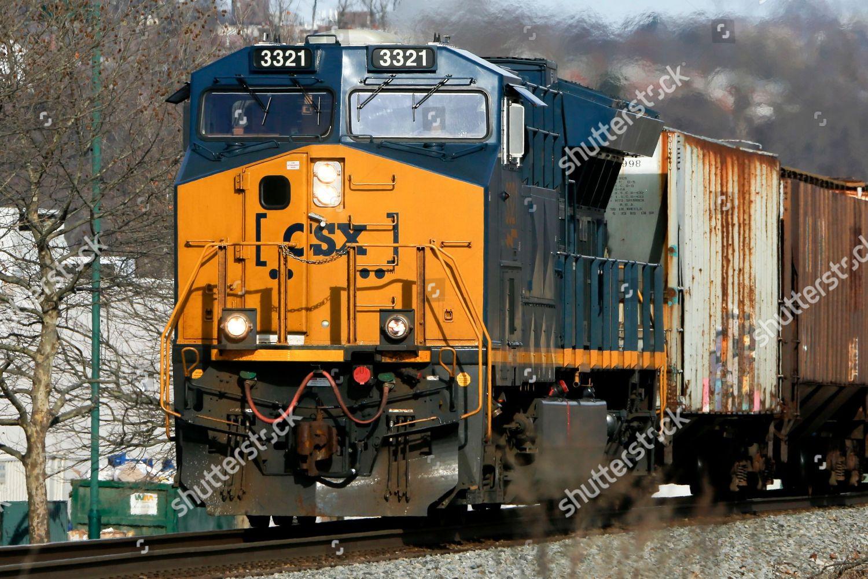 CSX railroad CSX freight train passes through Editorial