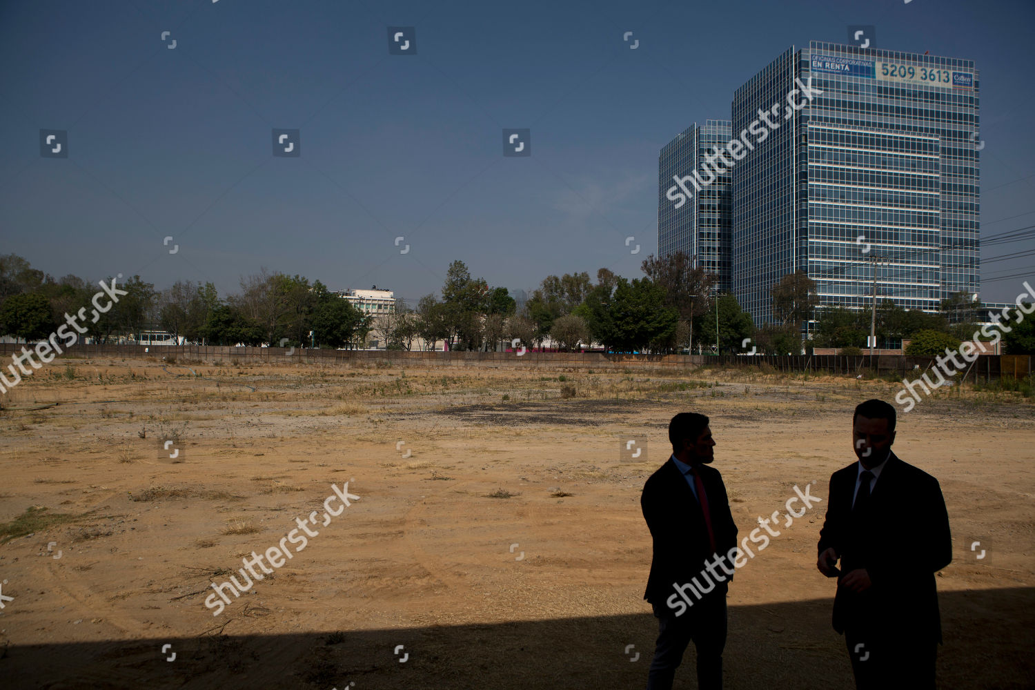 Men stand on property where new US Editorial Stock Photo