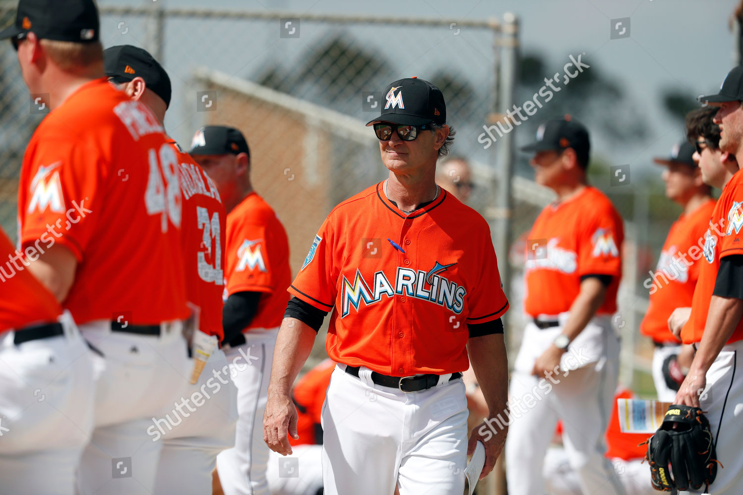 buy online 2d4d0 cad8e Miami Marlins manager Don Mattingly walks amongst Editorial ...
