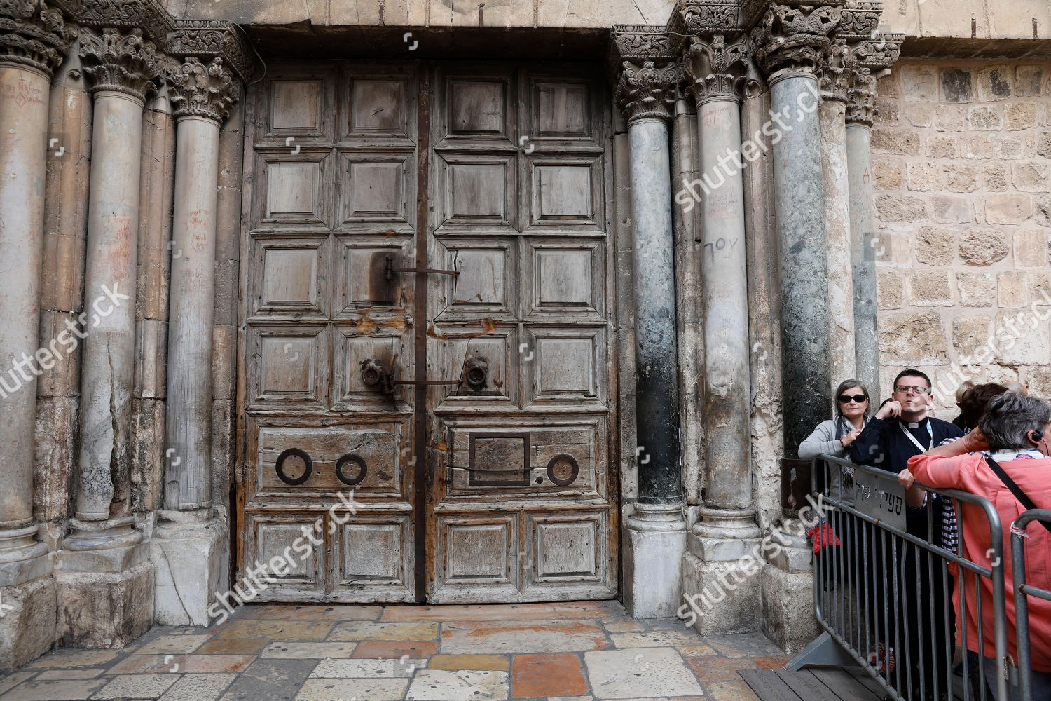 Visitors stand outside closed entrance door Church Editorial Stock