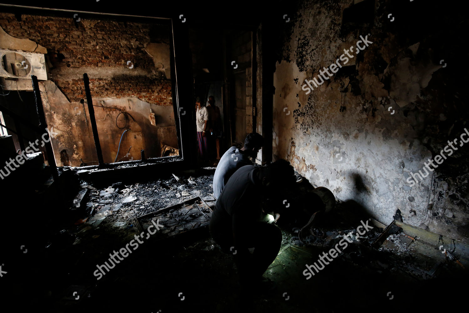 Sri Lankan Muslims inspect their fire gutted Editorial Stock