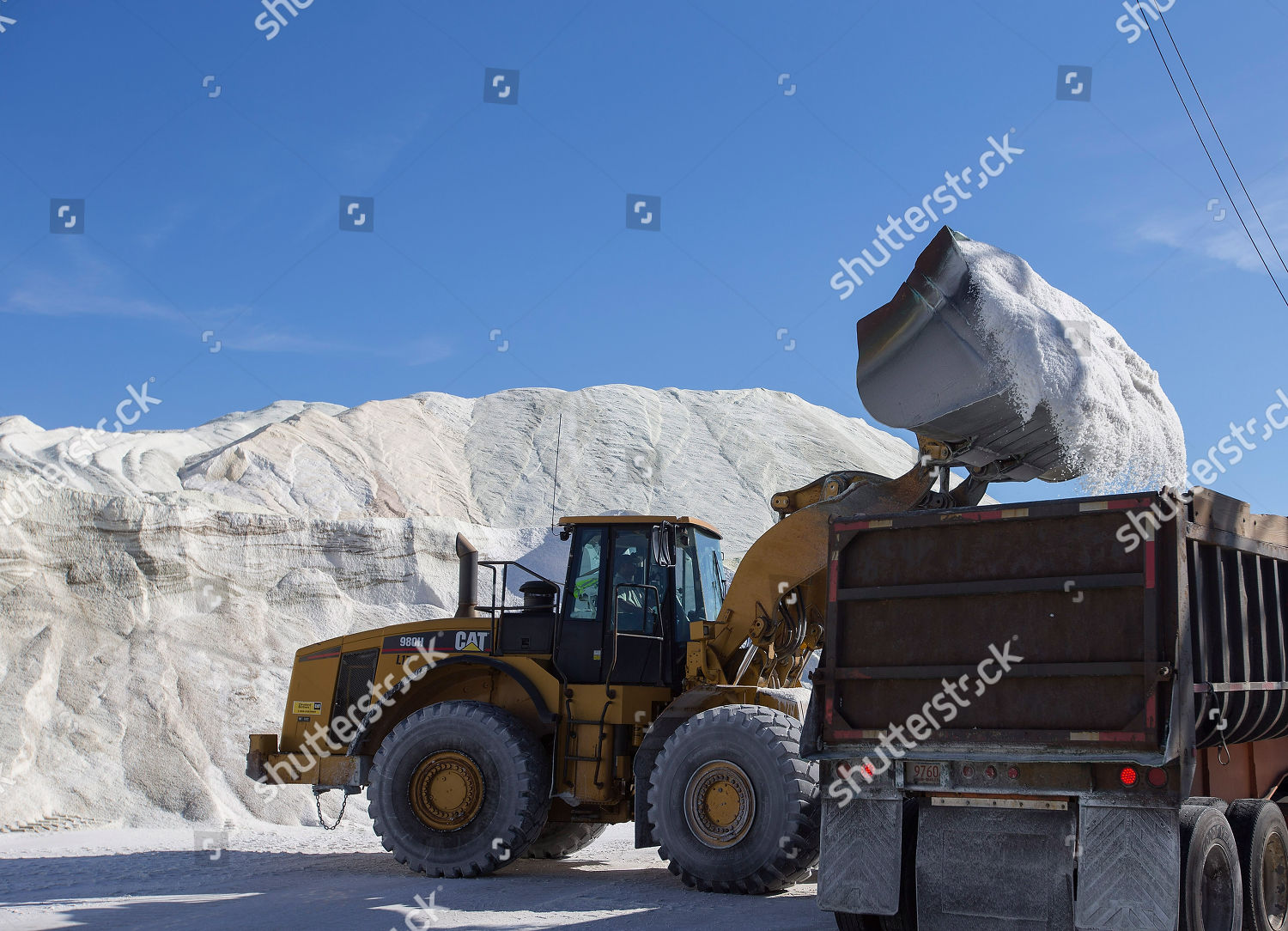 Crews load road salt into large trucks Editorial Stock Photo