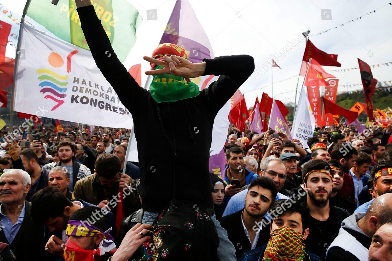 People chant slogans during Newroz celebrations marking