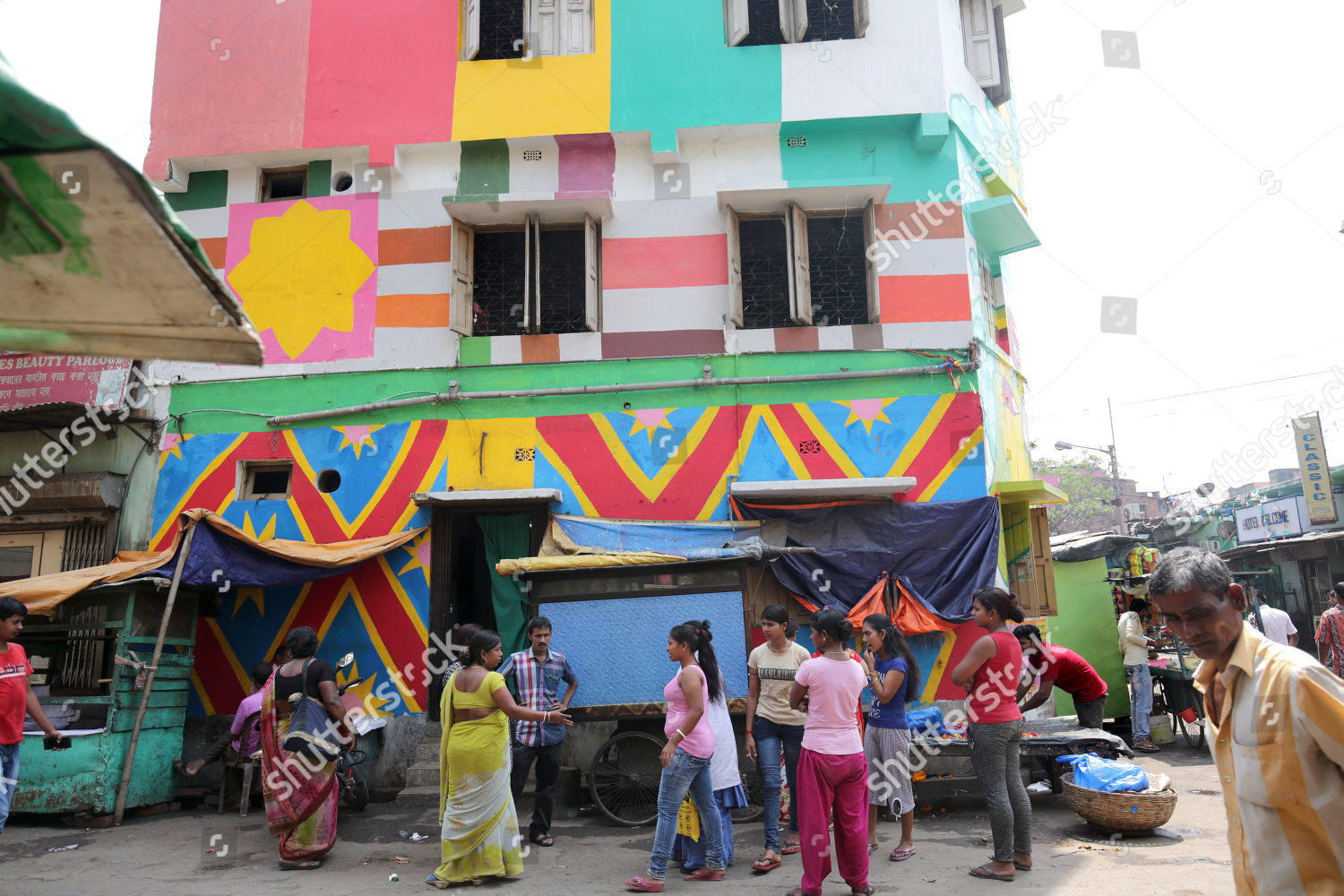 Indian commuters walk past painted wall Sonagachi Editorial