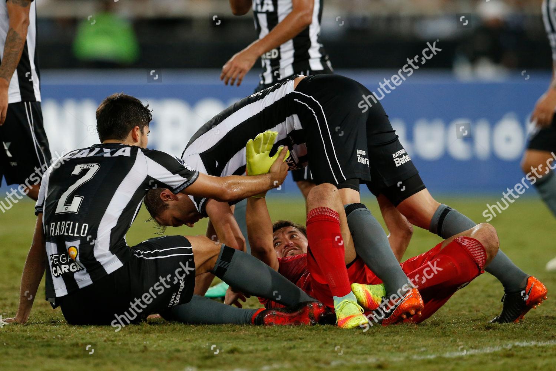 Goalkeeper Nicolas Peric Chiles Audax Italiano falls