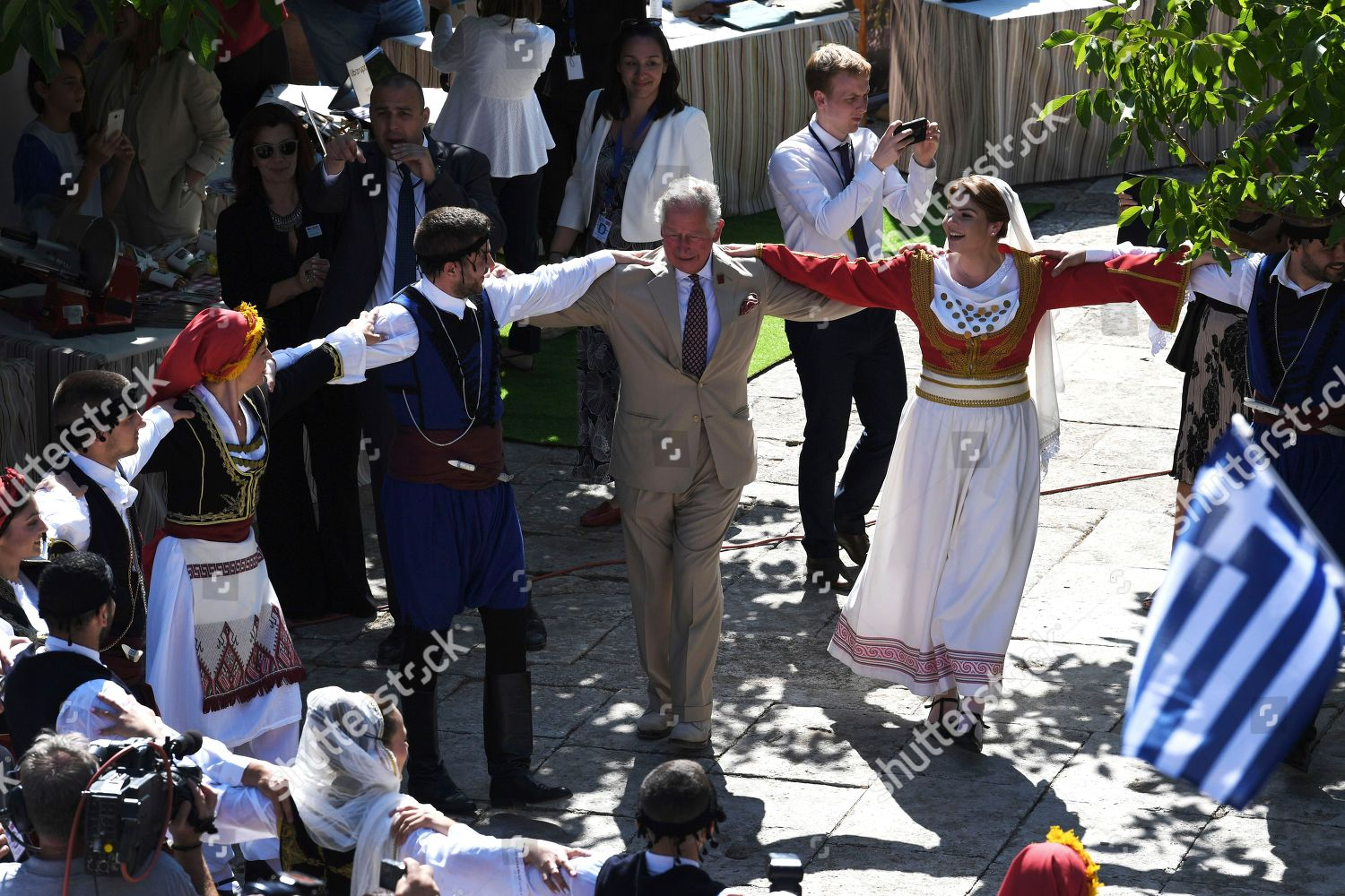 Britains Prince Charles dances traditional Greek music