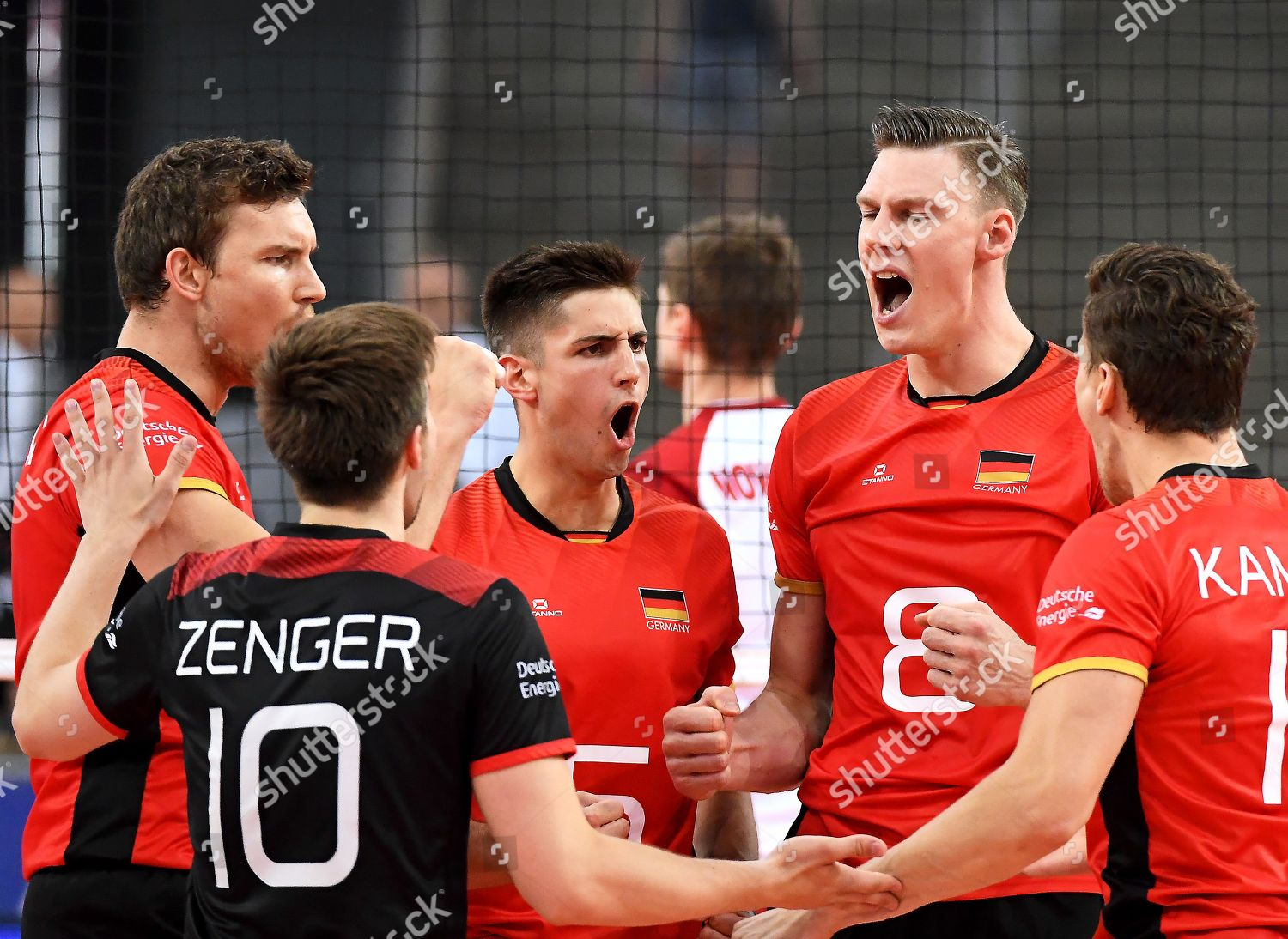 German players celebrate point during FIVB Volleyball Editorial