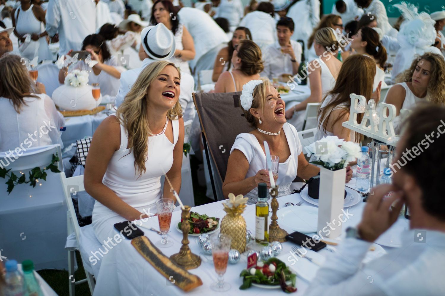 2f3990134e4ddf Thousands people dressed white share dinner by Editorial Stock Photo ...