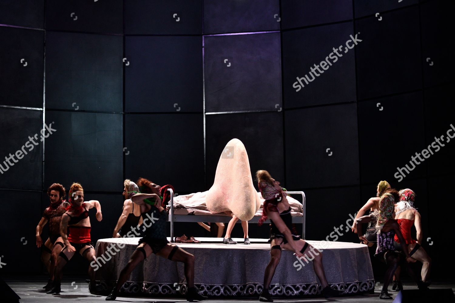 Dancers dance around nose on stage during Editorial Stock