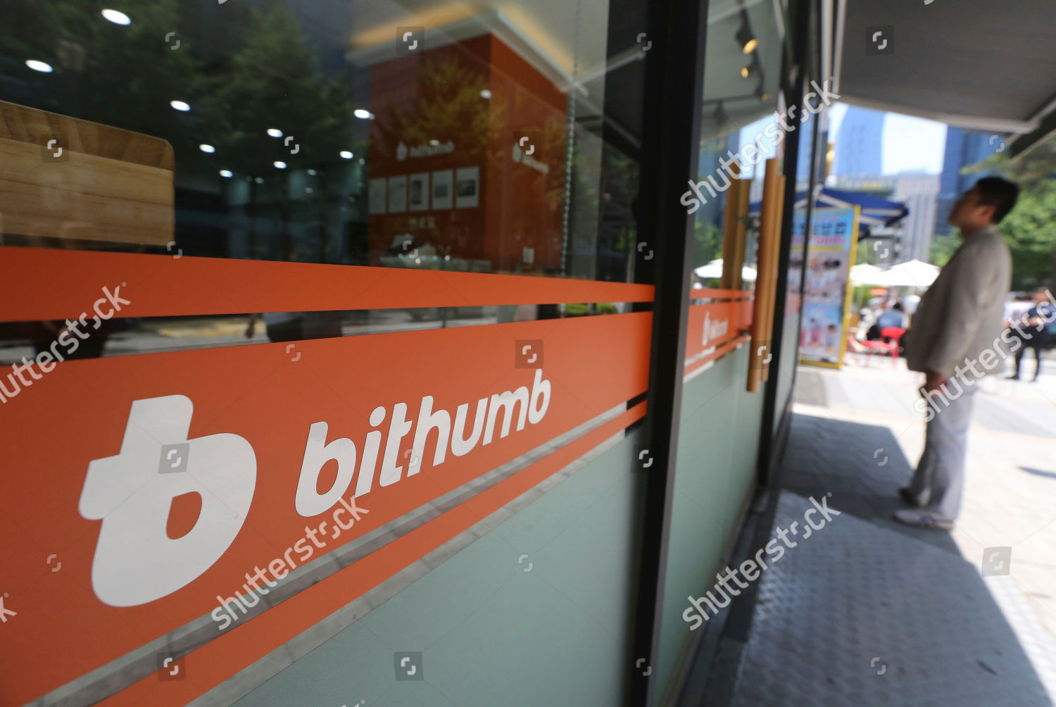 man watches prices bitcoin Bithumb cryptocurrency exchange Editorial