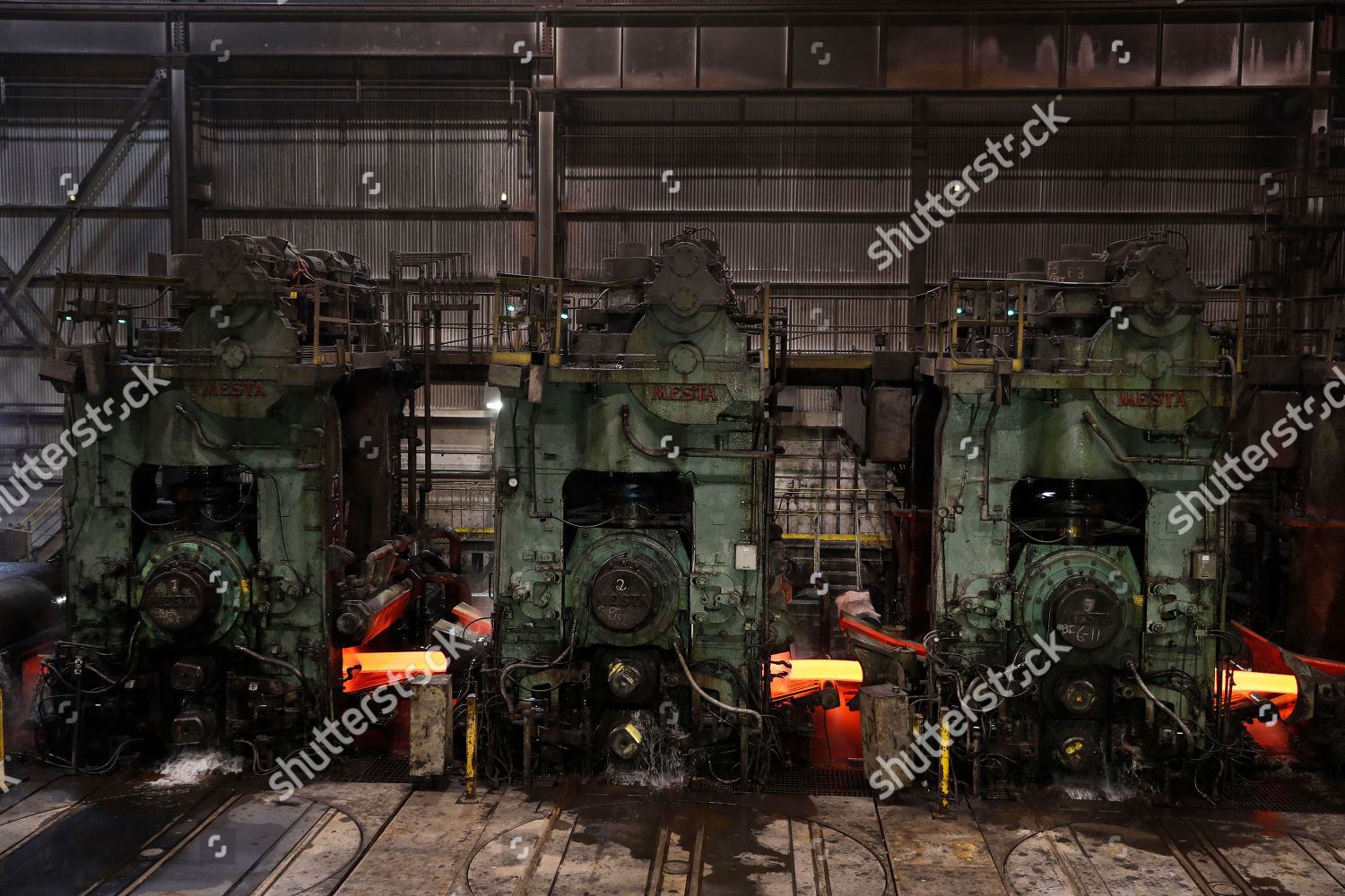 Steel passes through finishing stands hotstrip mill Editorial Stock