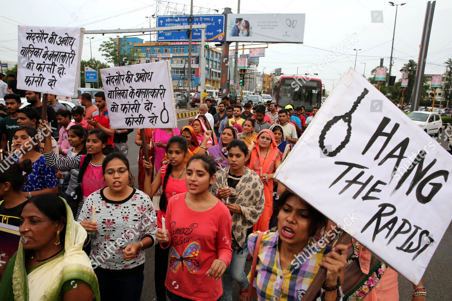 Indian people hold posters candles during candle Editorial Stock