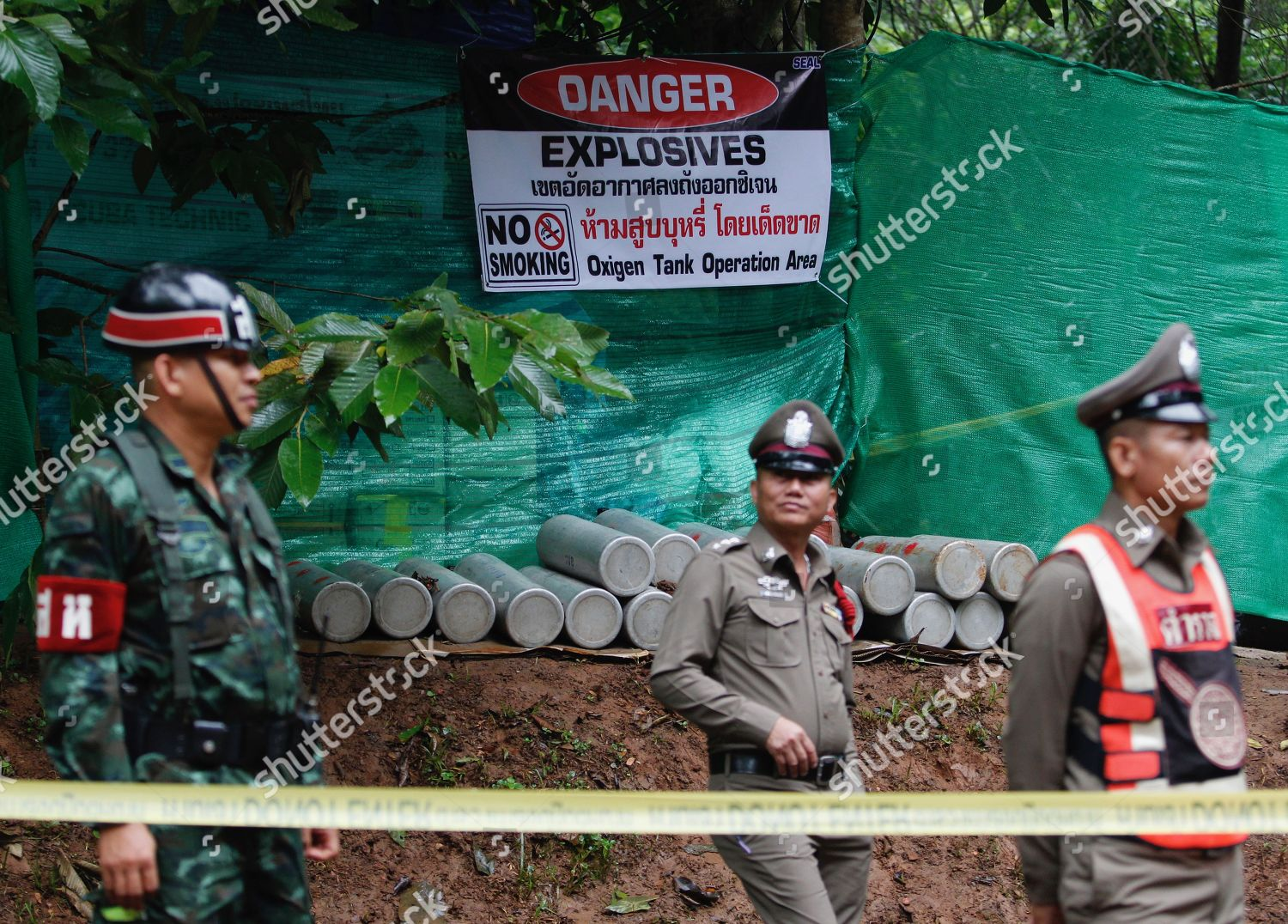 Thai police officers R military personnel L Editorial Stock Photo