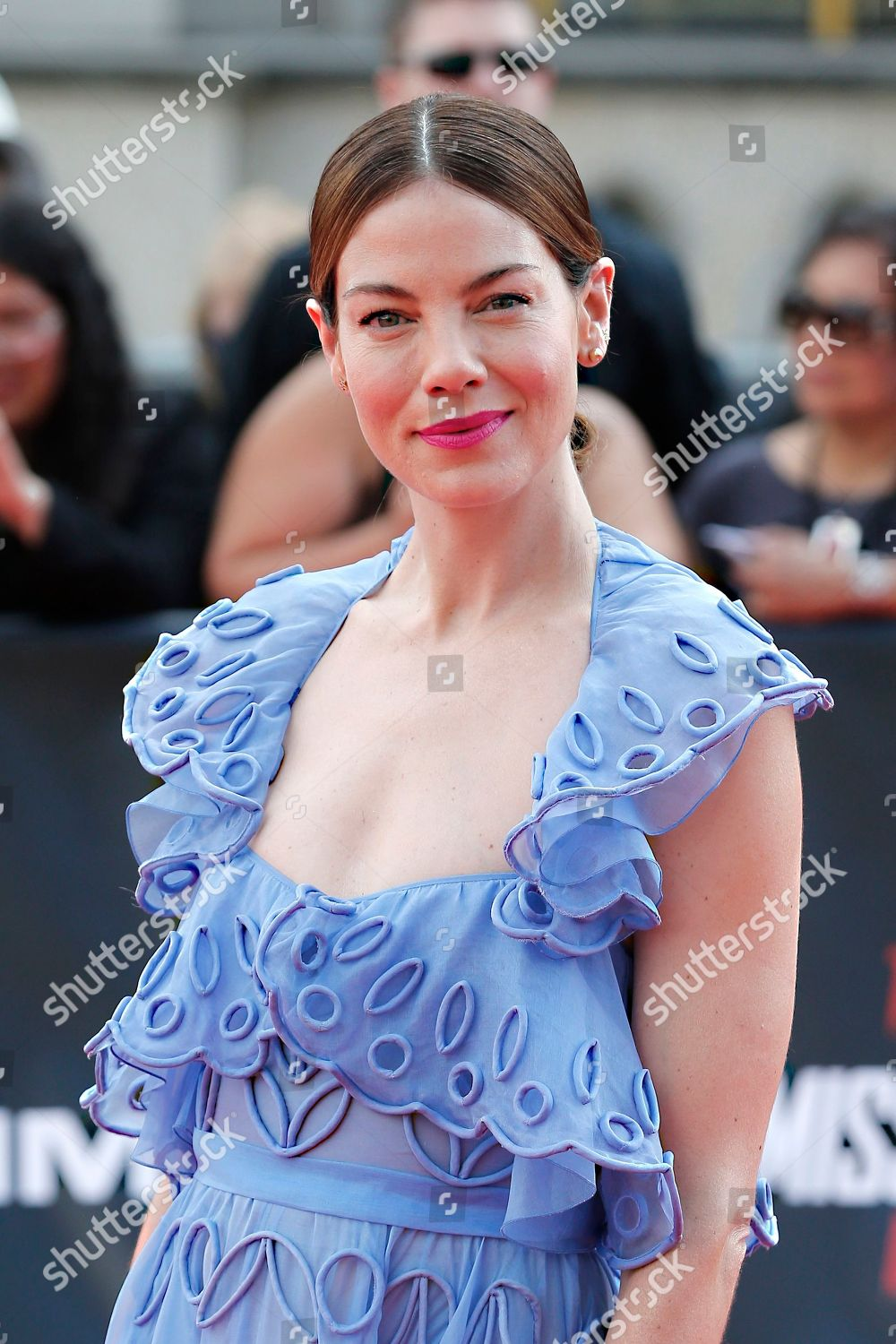Actress Michelle Monaghan poses photographers upon arrival