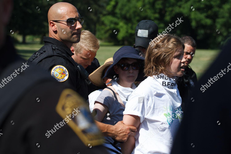 Police officers arrest protestors outside Berks County