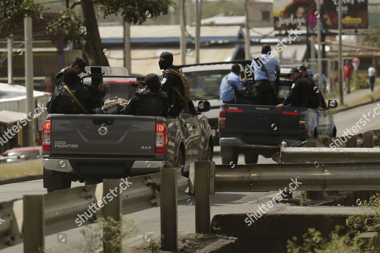 Policemen patrol Sandino neighborhood Jinotega Nicaragua 24