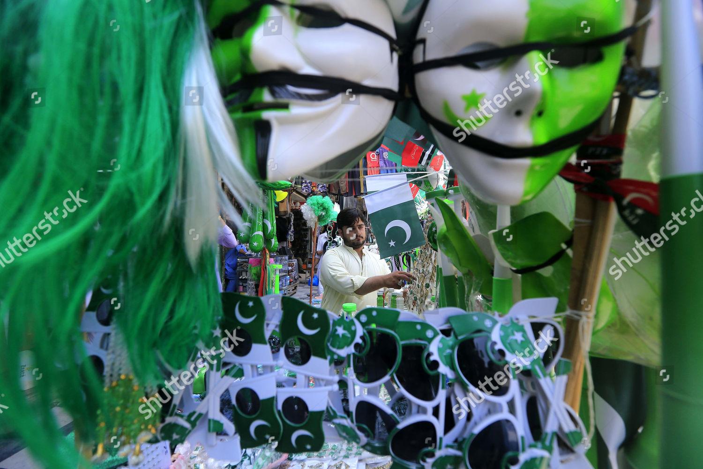 Pakistani vendor sells national flags items colors Editorial