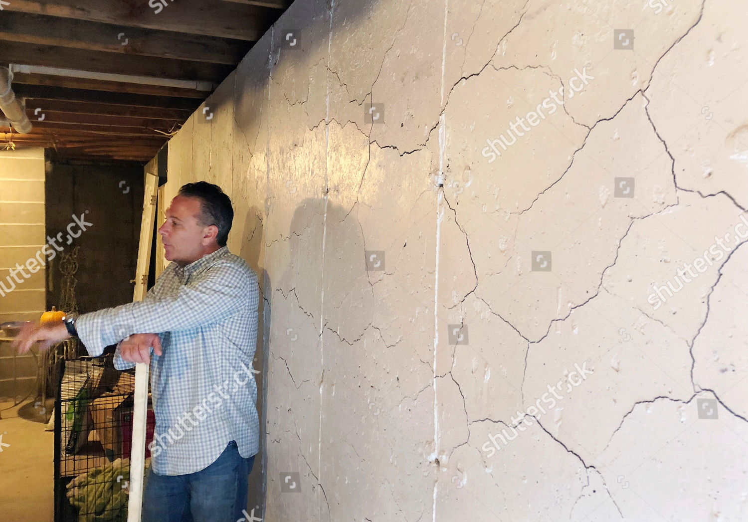 Homeowner Tim Hein stands his basement Willington Editorial Stock