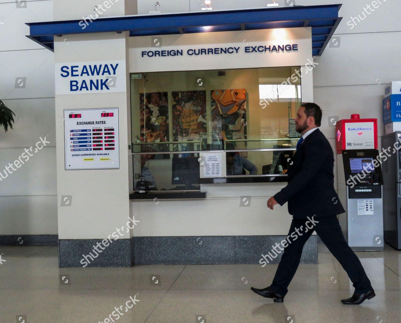 man walks past currency exchange Midway International